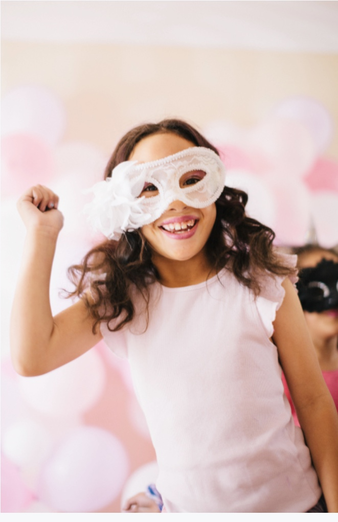 Happy girl wearing mask at slumber party